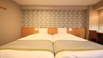 並んだベッドは小さなお子様をお連れのお客様に人気です