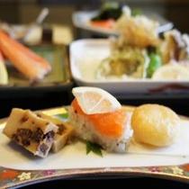 【お料理】当館の板前がこだわって作った 虹鱒の寿司・魚のすり身の手作り饅頭など。