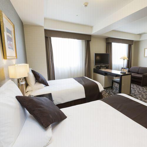 [客室]新館デラックスツイン(27.5m2/ベッド幅120cm2台+ソファーベッド1台)