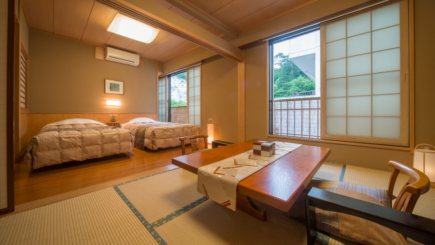 ◆和洋室【和室6畳+ツインベッド】バストイレ付き