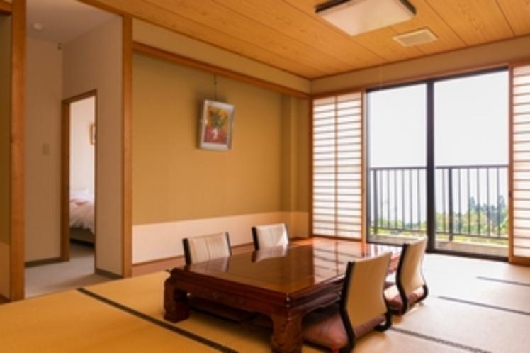 16畳と4つのベッドルームがある和洋室