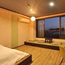 ダブルベッドを配した和洋室
