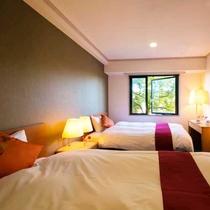 ■リニューアル・ツイン■客室の窓からホテル周辺の緑を感じる癒しの空間。