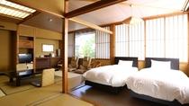 和洋室 ベッドのある落ち着いた雰囲気のお部屋でお寛ぎください