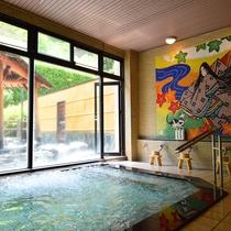*【大浴場】壁面には、大迫力の式部のタイル画がございます。
