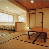 和洋室 8畳の和室とツインベッドを完備したバストイレ付の和洋室です