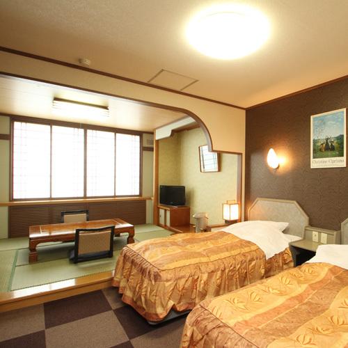 和洋室〜ツインベッド+6畳