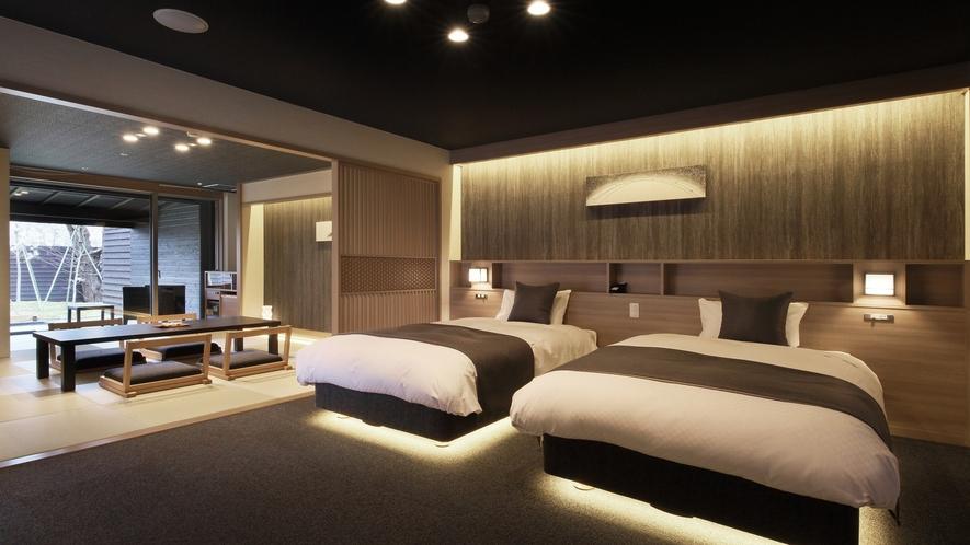 『冬月-とうげつ-』ベッドルームには個別に調光できるライトやコンセント。他、50インチの4Kテレビ