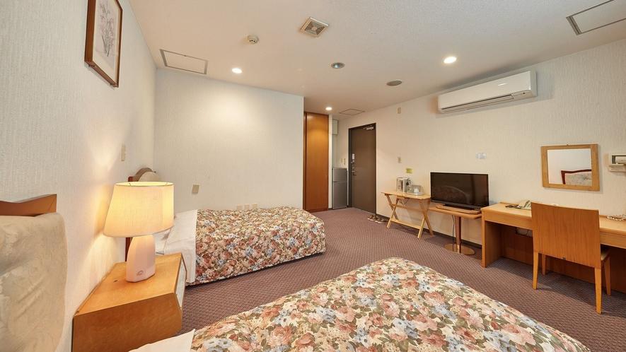 客室一例/夜はベッドで安眠の夜をお過ごしください。
