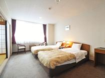 【客室:和洋室(和室8畳)】シングルベッド2台を設置した洋室