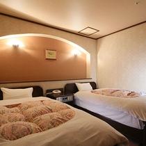 最上階【寛ぎのお部屋】ベッドルームの一例