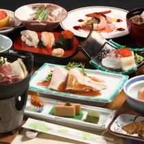 ご夕食の献立一例。青森と秋田の県境の味覚をご賞味ください。